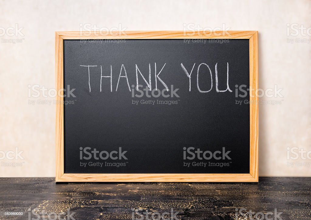 handwriting text thank you is written in chalkboard stock photo