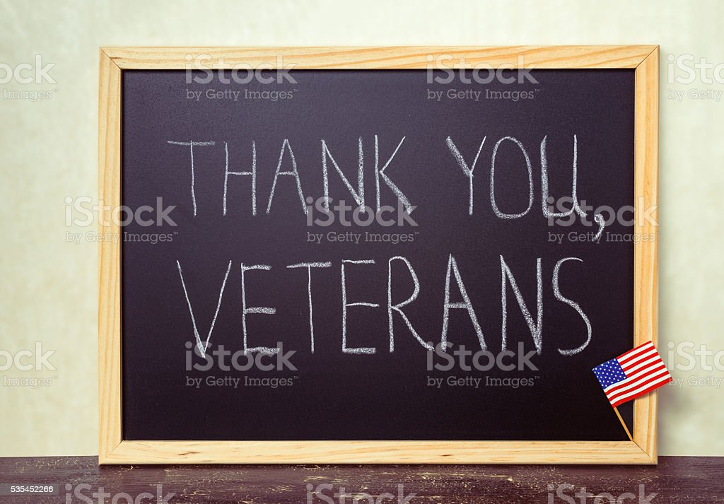 handwriting text thank you veterans is written in chalkboard stock photo