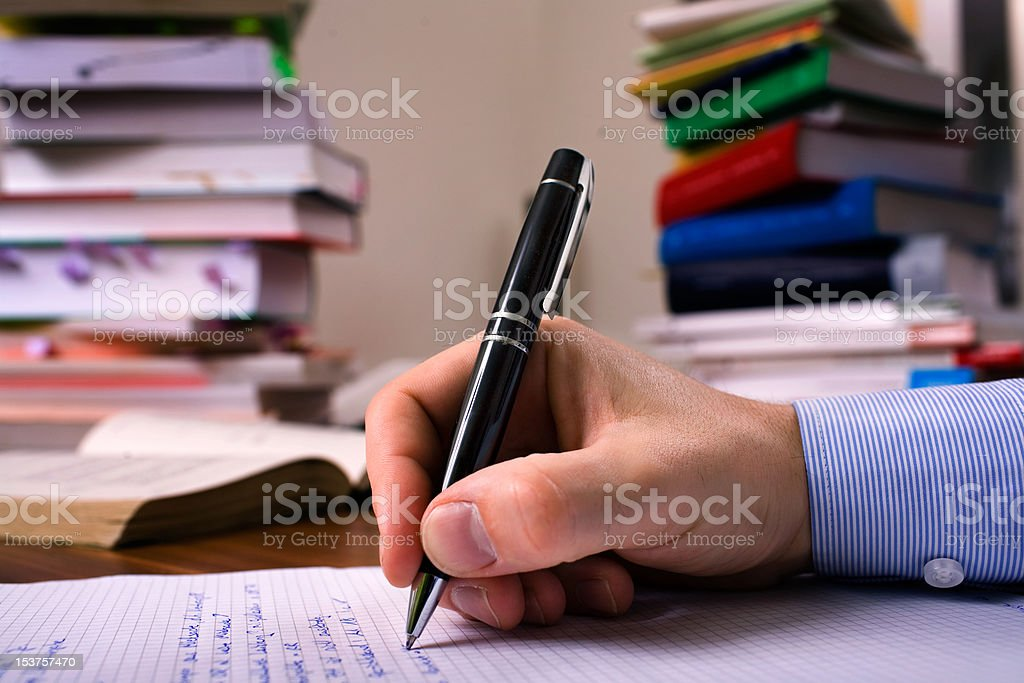 Handwriting with Books for Education royalty-free stock photo