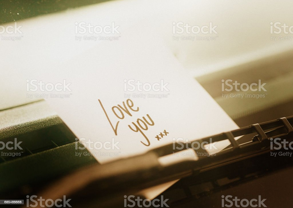 Handwritten note tucked under windscreen  wiper says 'Love You' stock photo