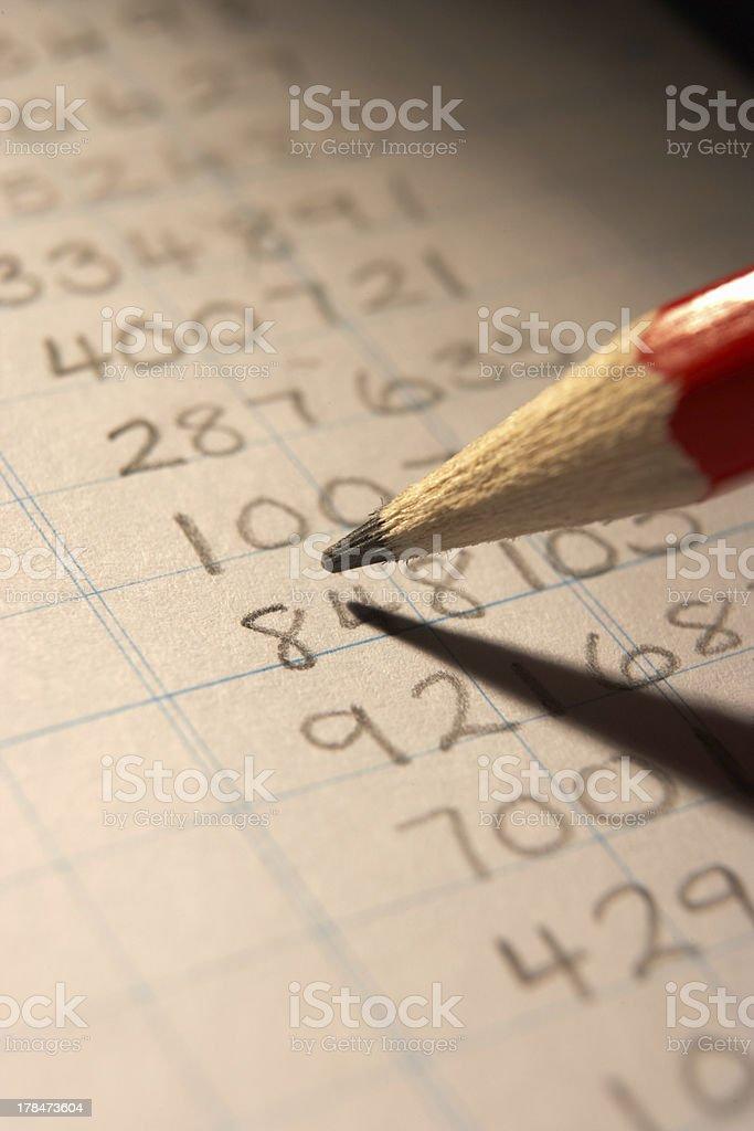 Handwritten numbers in ledger stock photo