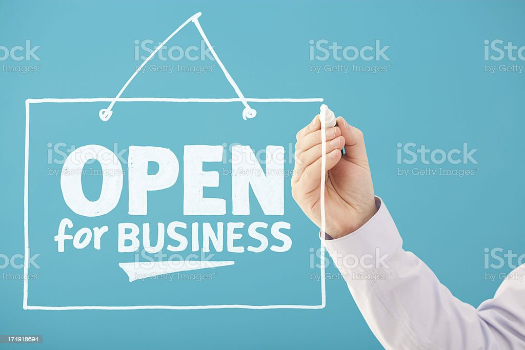A handwritten OPEN FOR BUSINESS in white royalty-free stock photo
