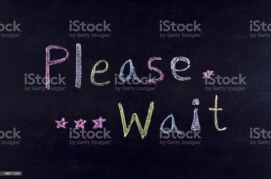 handwritten 'please wait' stock photo