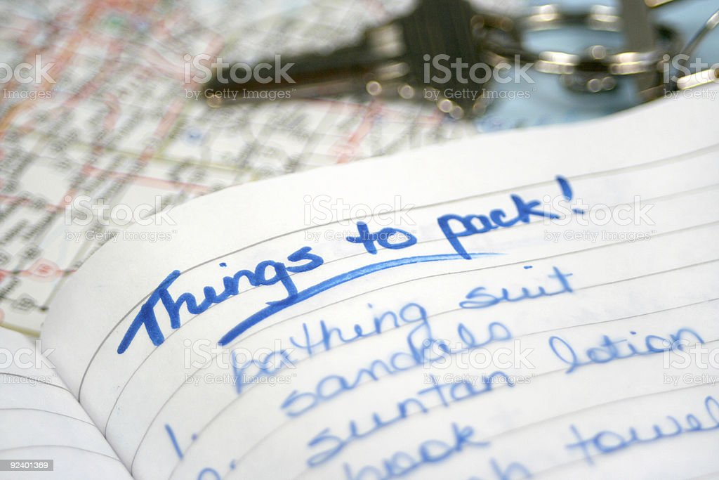 Handwritten reminder list on lined paper for holiday packing stock photo