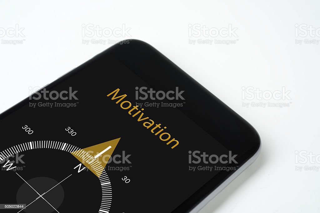 handy compass with text and Arrow Motivation stock photo