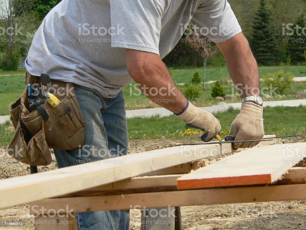 Handy man preparing to cut wooden boards stock photo