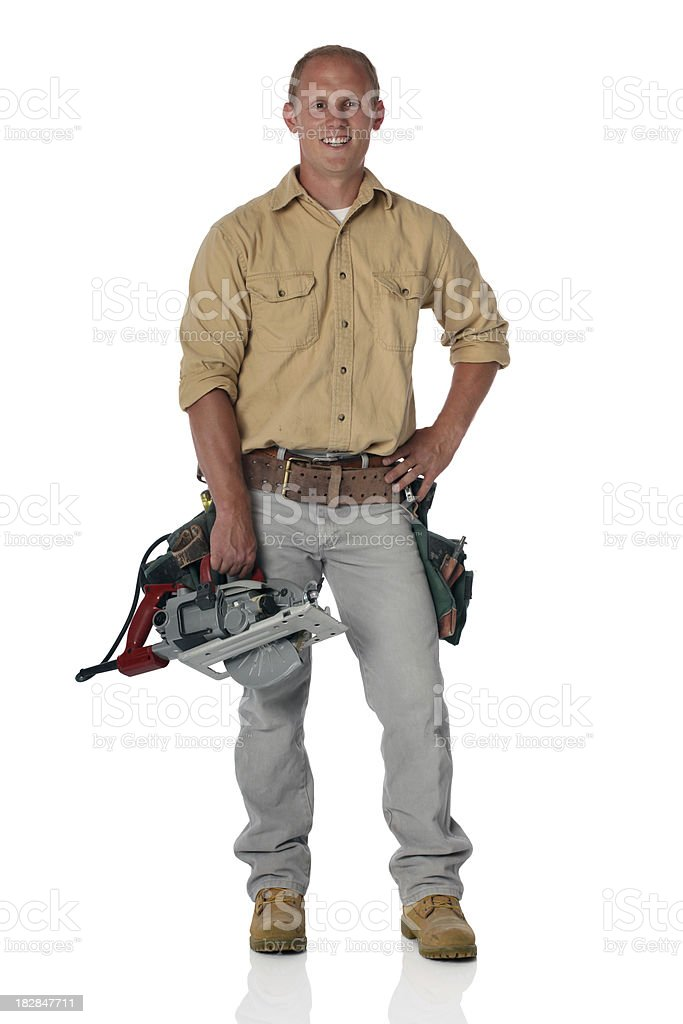 Handy man with tool belt and rotary saw royalty-free stock photo