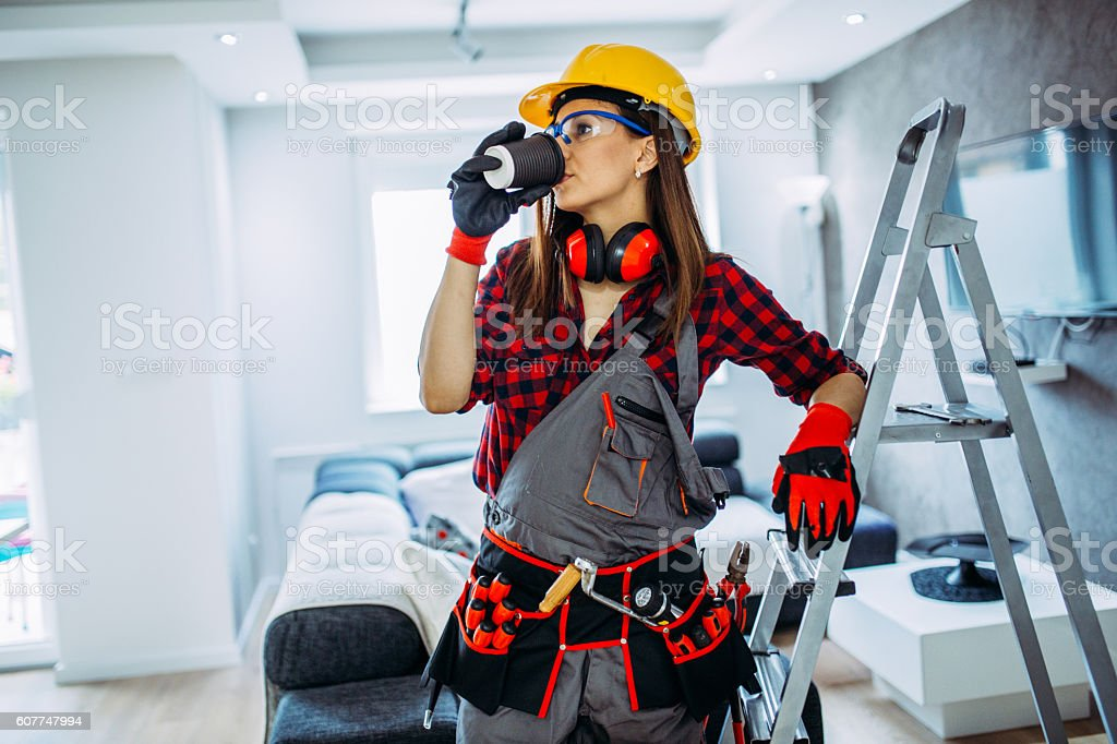 Handy woman on a break stock photo