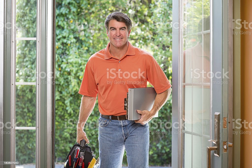 Handyman At Front Door royalty-free stock photo