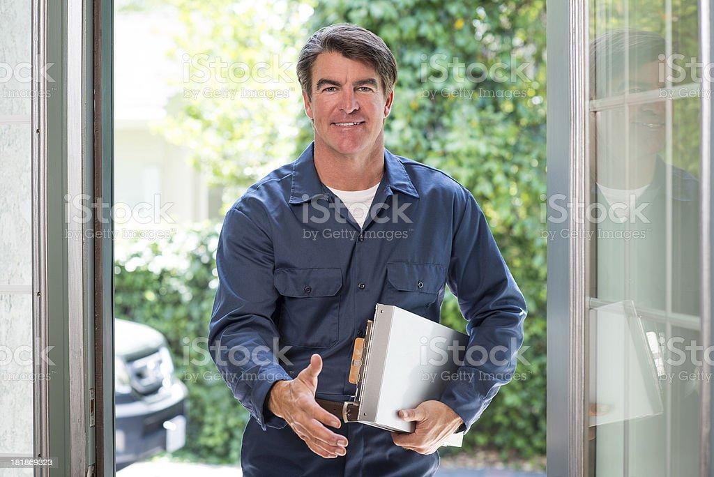 Handyman At Front Door royalty-free stock photo