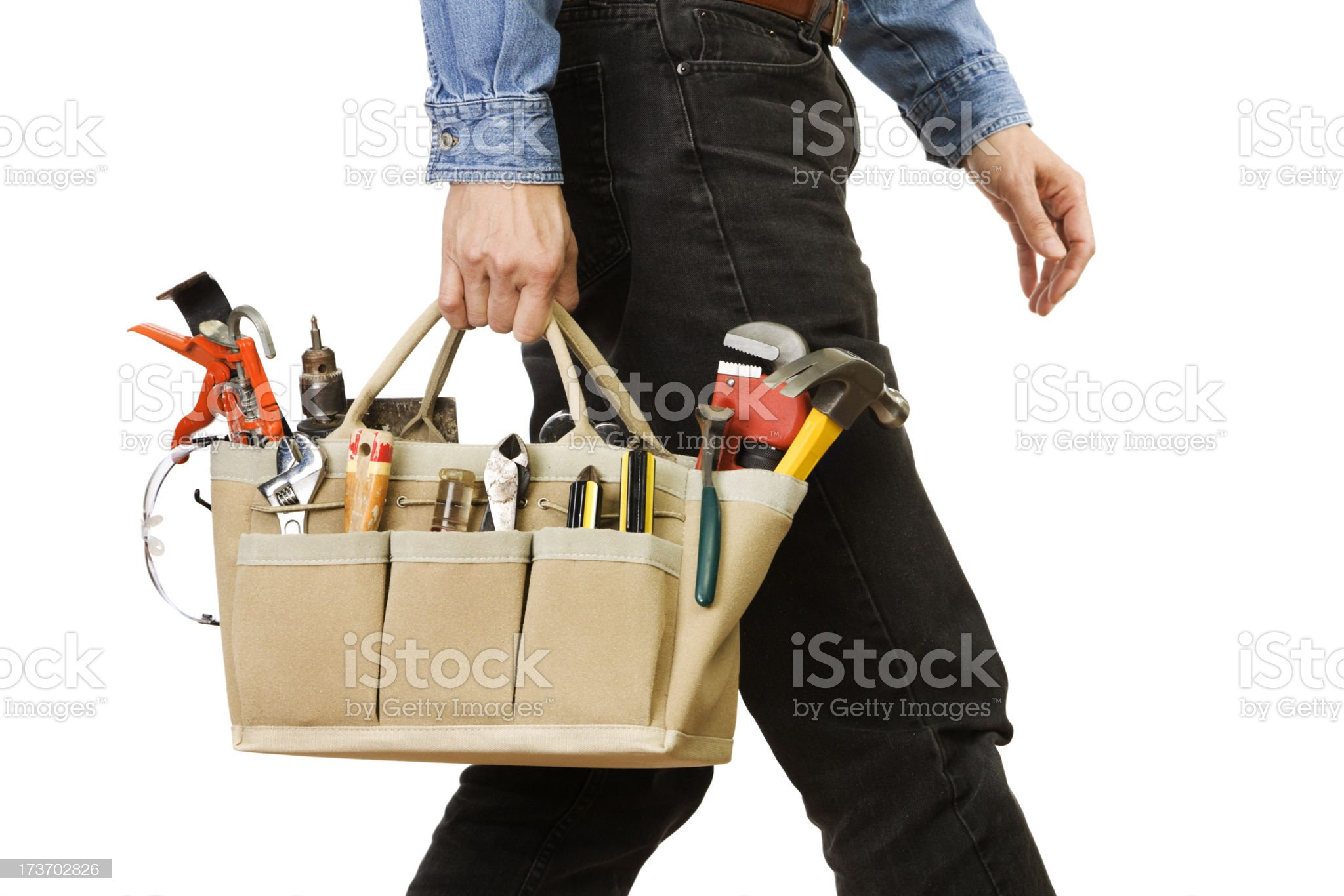 Handyman Carrying Tools, Home Repair Equipment Kit on White Background royalty-free stock photo