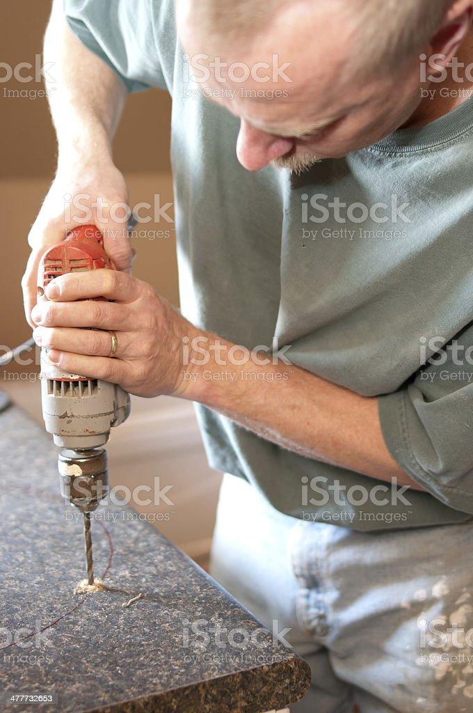 Handyman doing Bathroom Renovation stock photo
