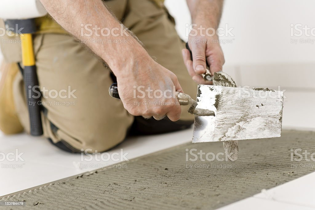 Handyman doing home renovation royalty-free stock photo