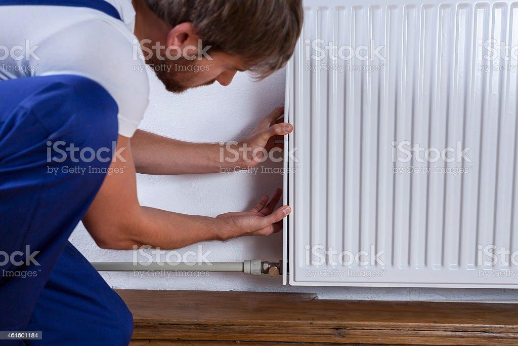 Handyman fix the radiator stock photo