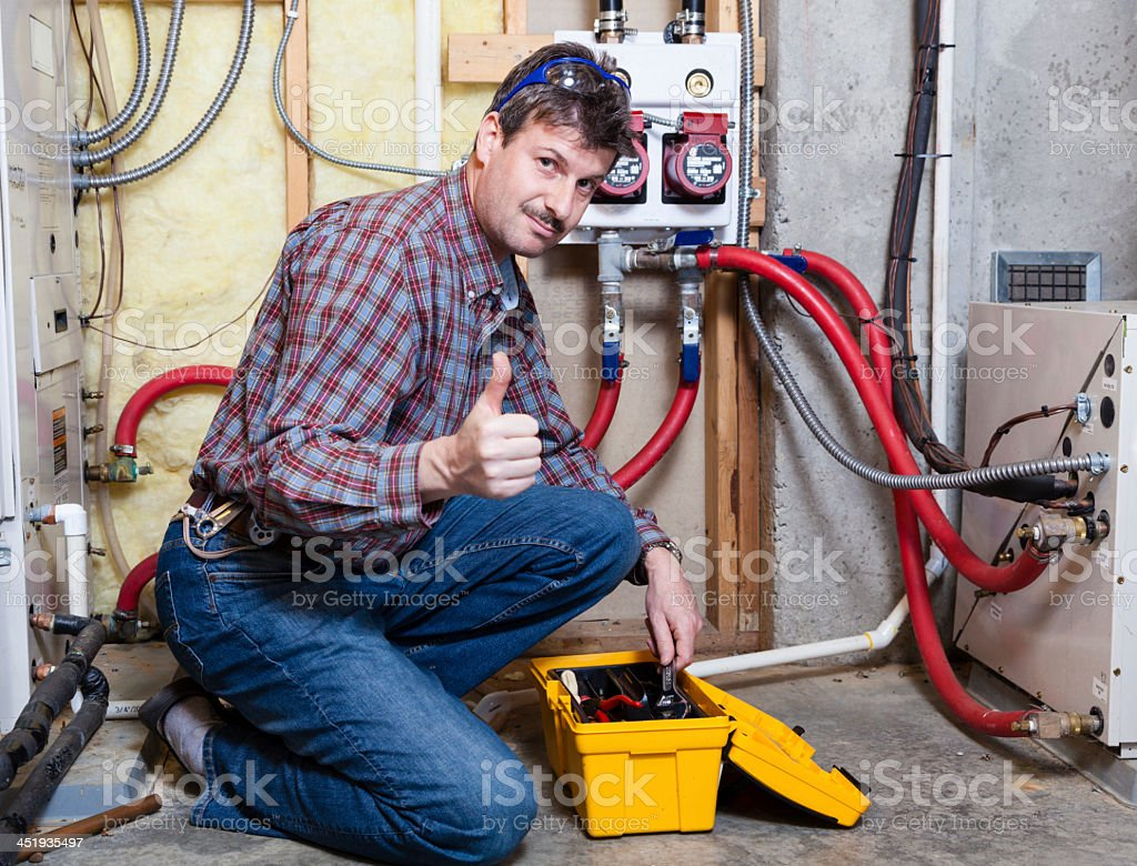A handyman giving the thumbs up stock photo