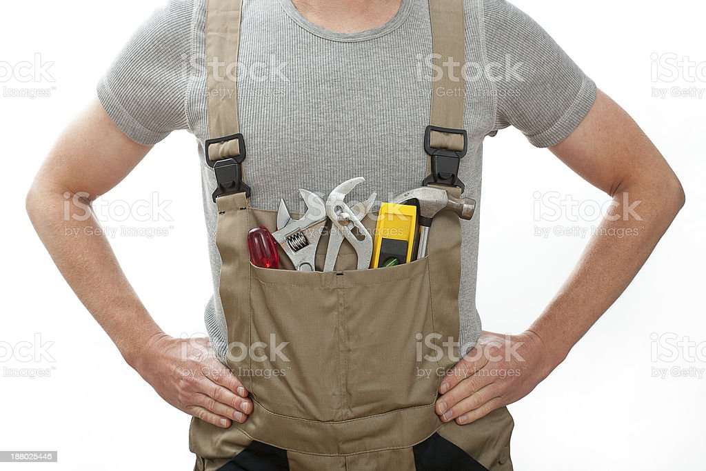 Handyman in overalls stock photo