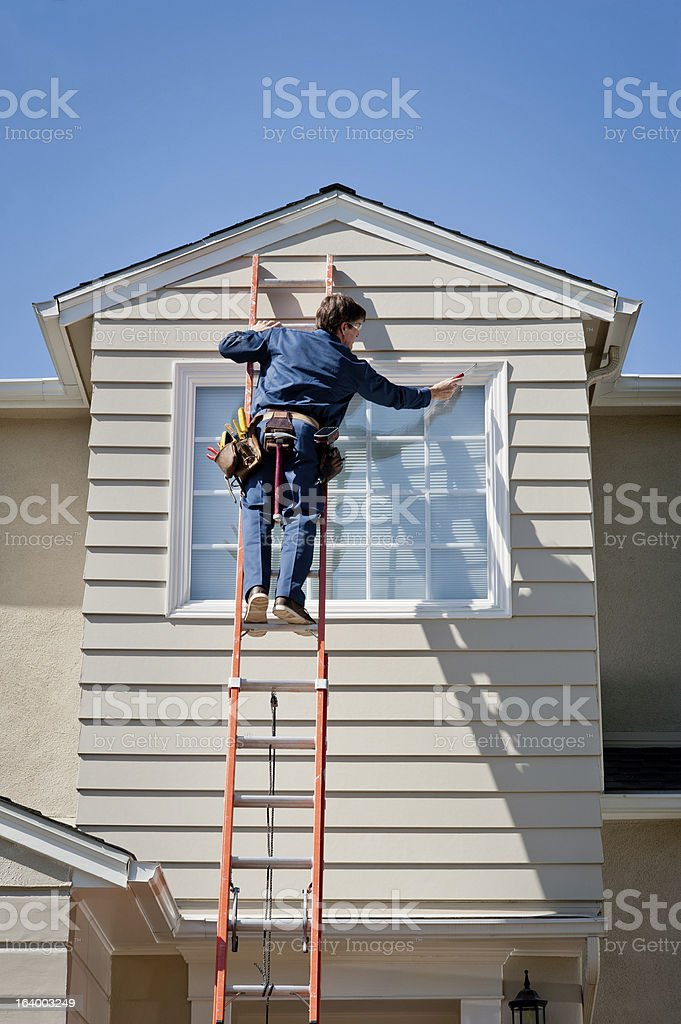 Handyman In Uniform Inspecting stock photo