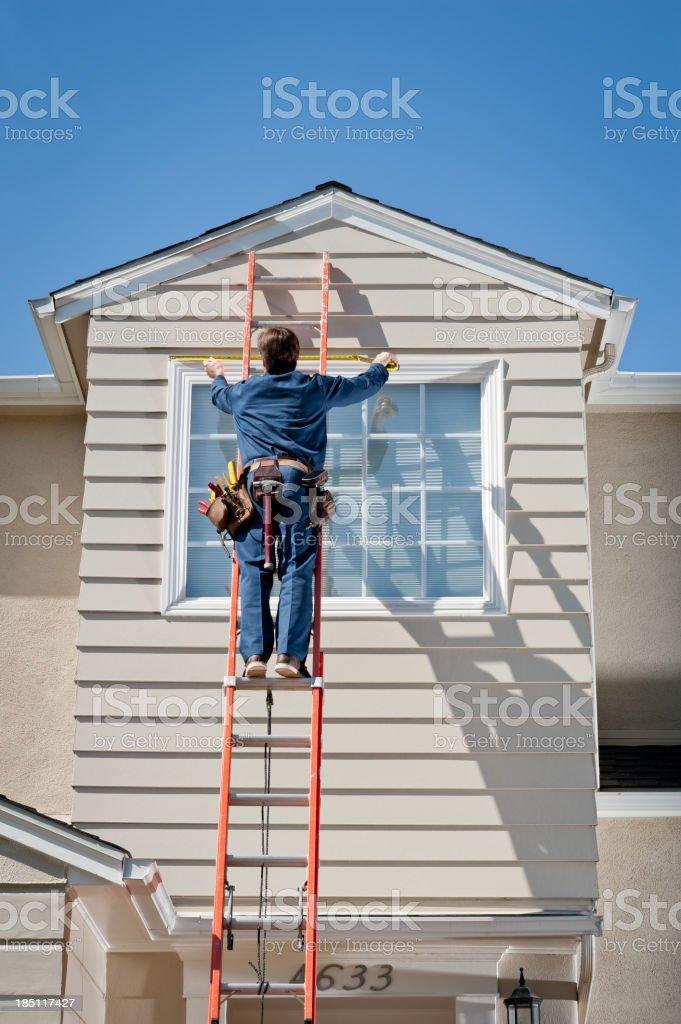 Handyman In Uniform Measuring royalty-free stock photo