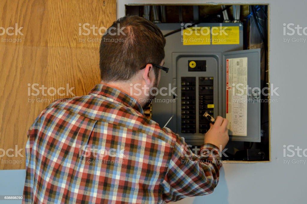 Handyman Inspecting an Electric Box stock photo