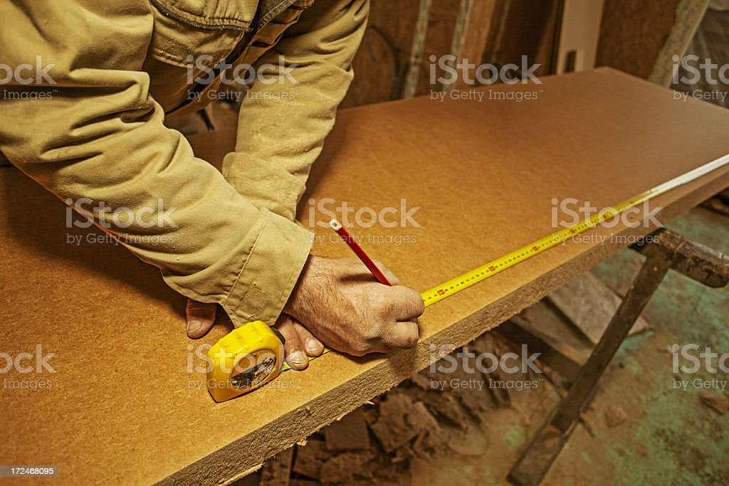 Handyman measure insulation material royalty-free stock photo