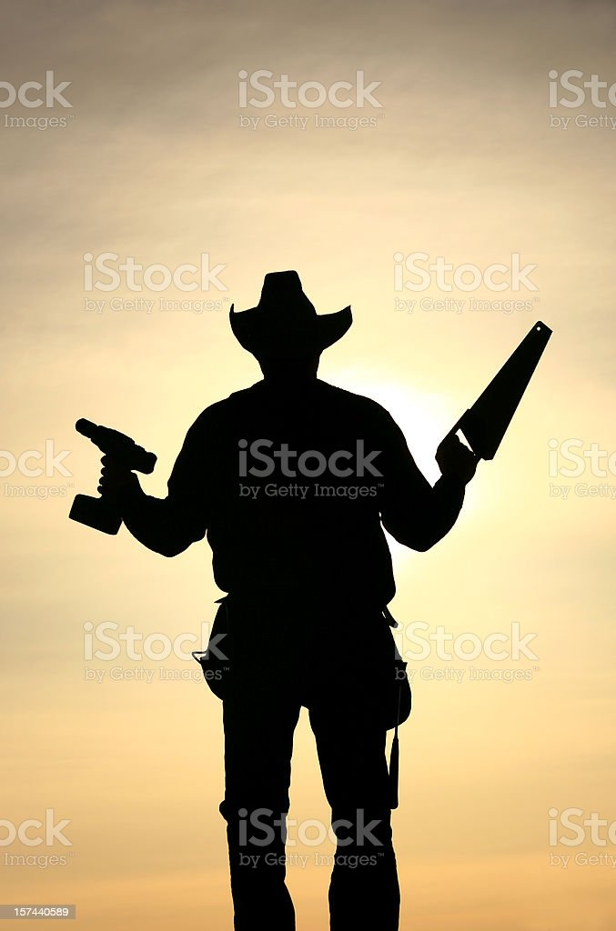 Handyman Silhouette Holding Construction Tools stock photo