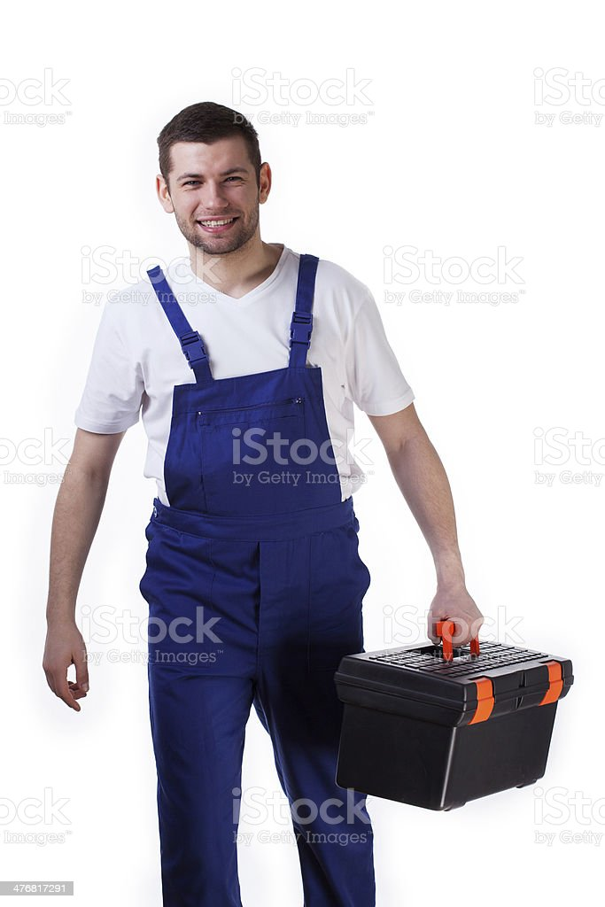 Handyman walking with toolbox royalty-free stock photo