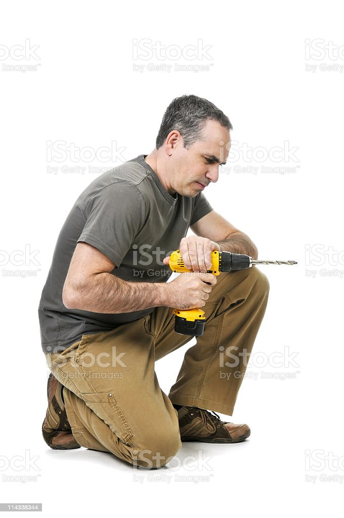 Handyman with a drill royalty-free stock photo