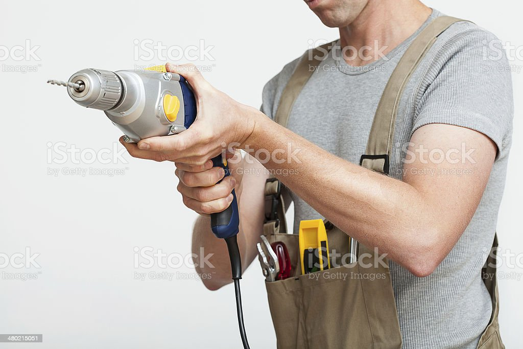 Handyman with drill royalty-free stock photo