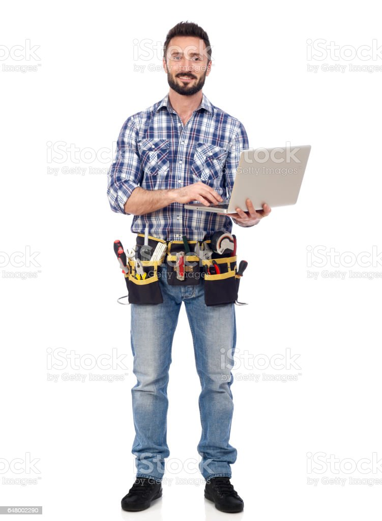 Handyman with laptop stock photo