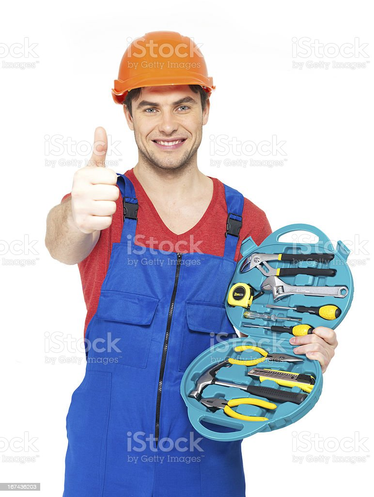 handyman with tools showing thumbs up sign royalty-free stock photo