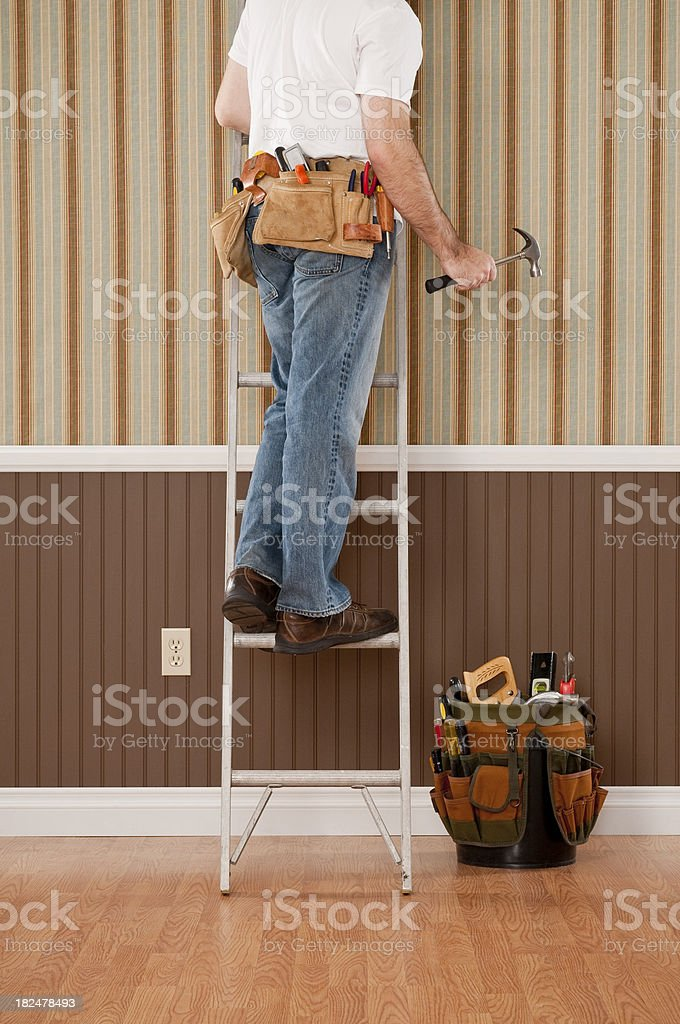 Handyman Working In Empty Room royalty-free stock photo