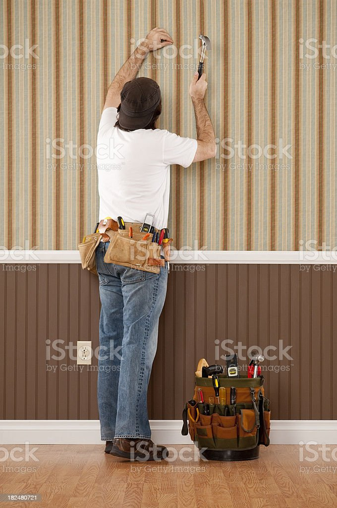 Handyman Working In Empty Room royalty-free stock photo