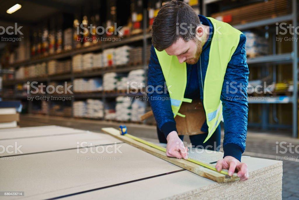 Handyman working in warehouse stock photo