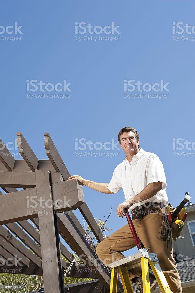 Handyman Working On Pergola royalty-free stock photo