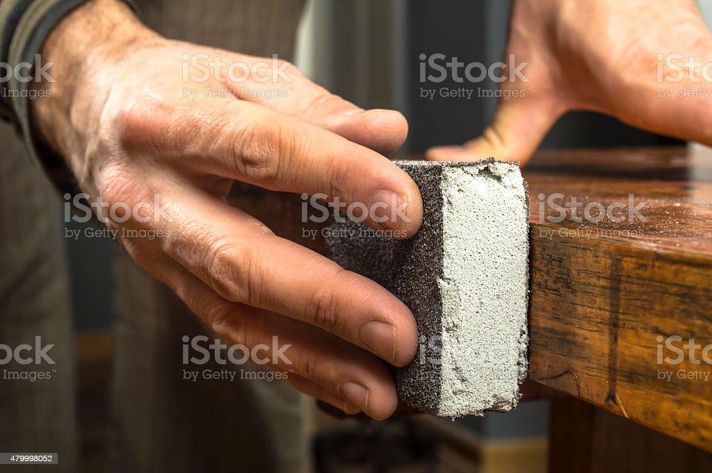 Handyman working with sandpaper stock photo