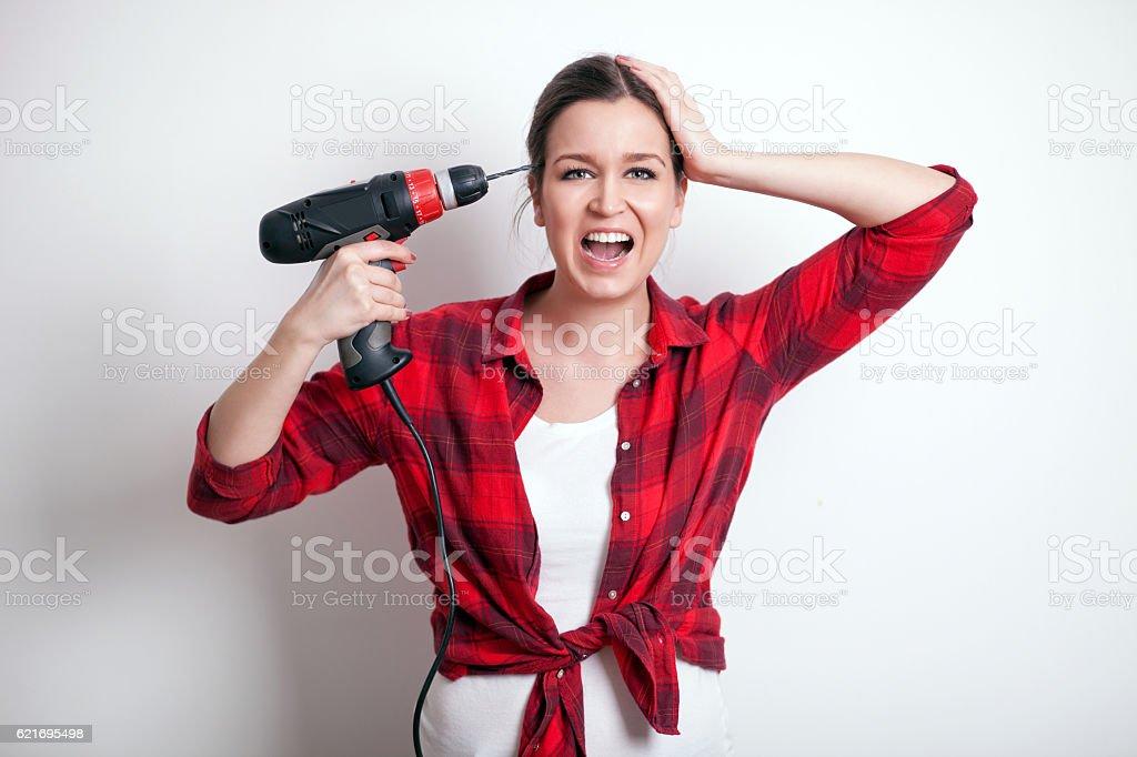 Handywoman under stress stock photo