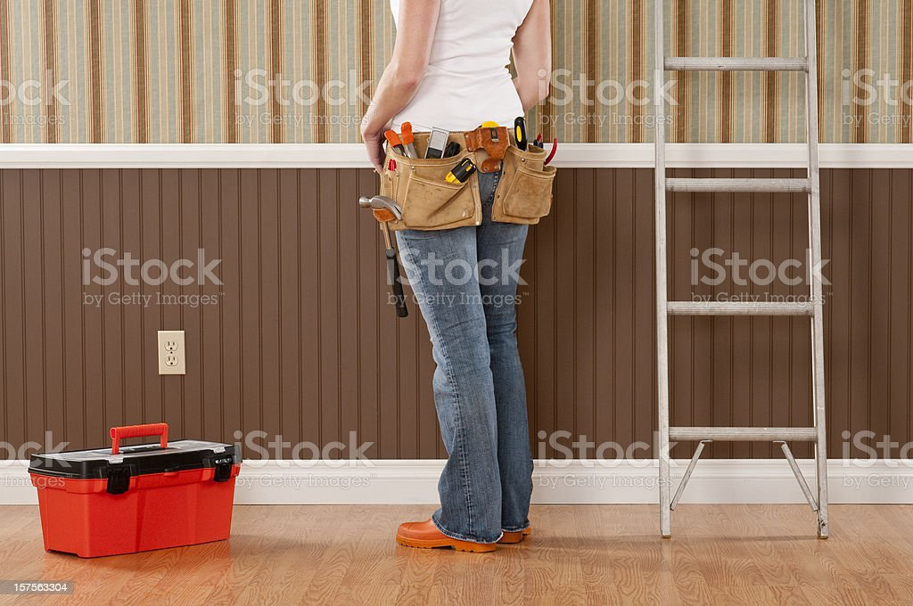 Handywoman Working In Empty Room royalty-free stock photo