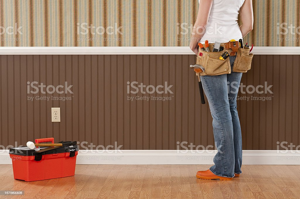 Handywoman Working In Empty Room royalty-free stock photo
