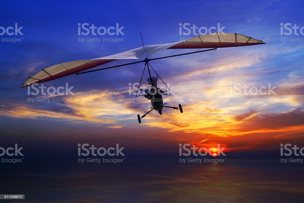 Hang glider in the sunset stock photo