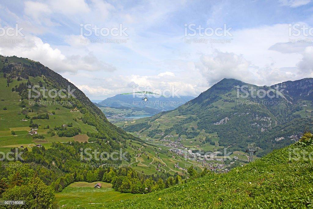 Hang glider pilot in Swiss Alps taken in summer, stock photo