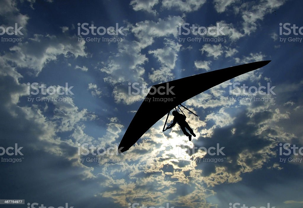 Hang glider silhouette on sky stock photo