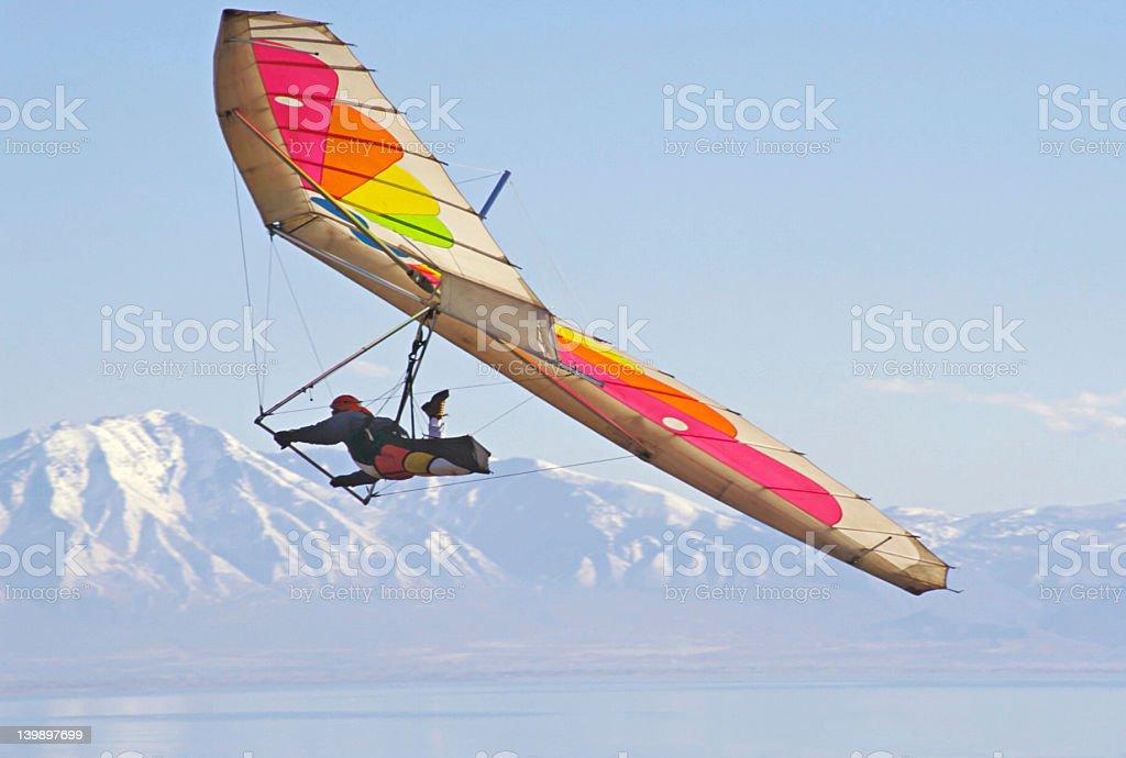 A hang glider soaring through the air on a hang glider stock photo