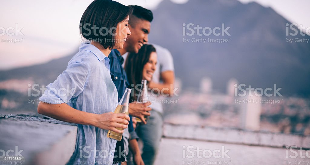 Hang out on rooftop with friends after work stock photo