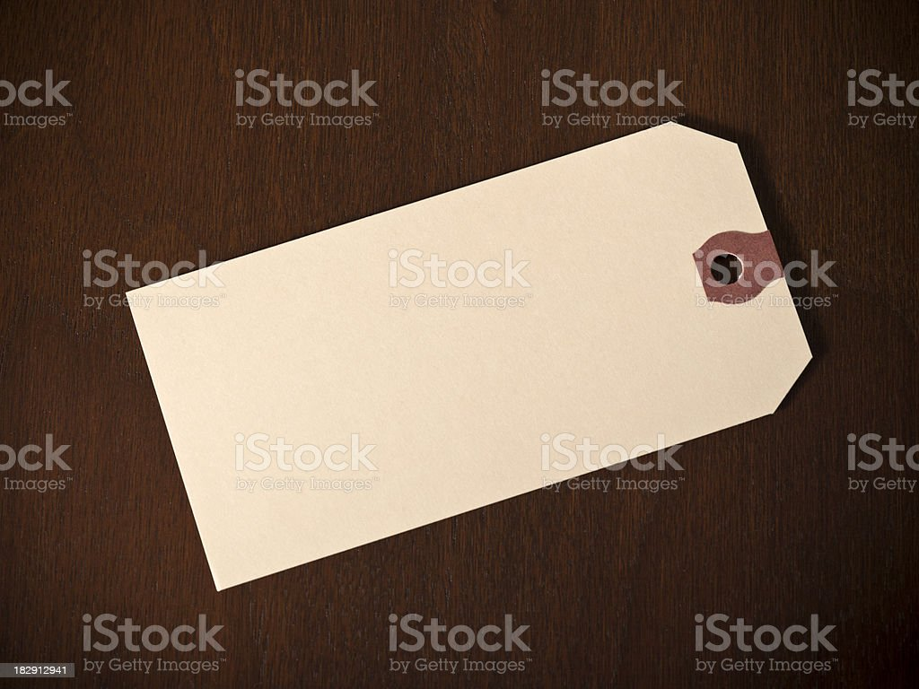 Hang price tag on a wooden desk royalty-free stock photo