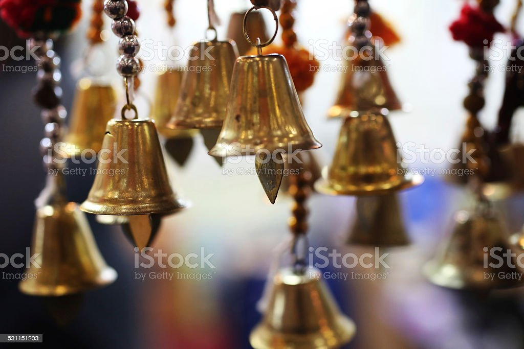 Hanged many bells in a row stock photo