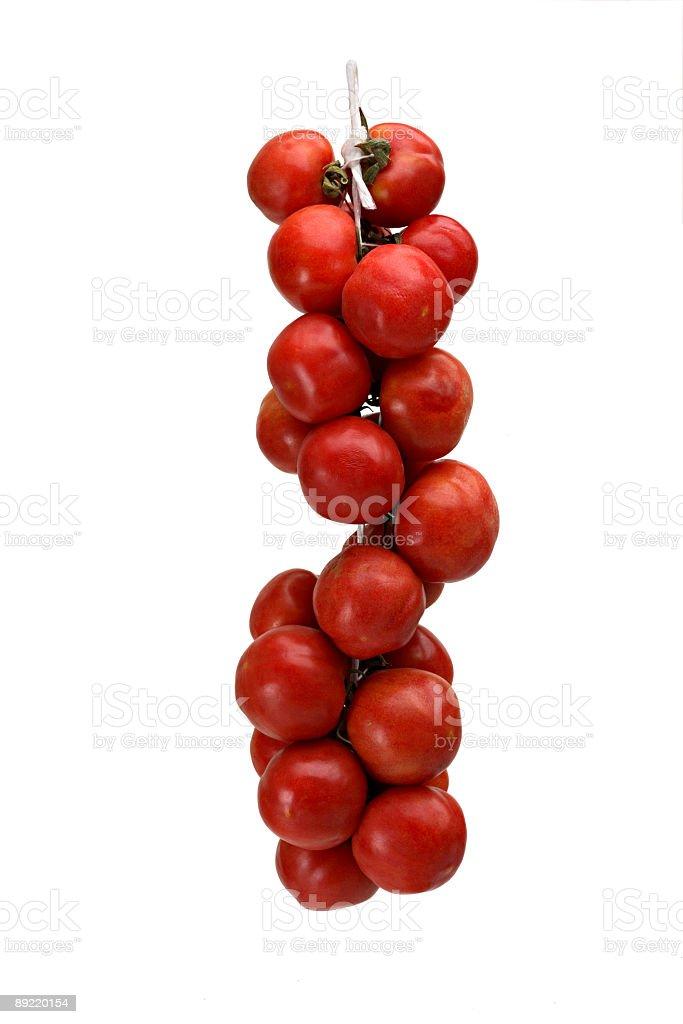 Hanged tomatoes. stock photo