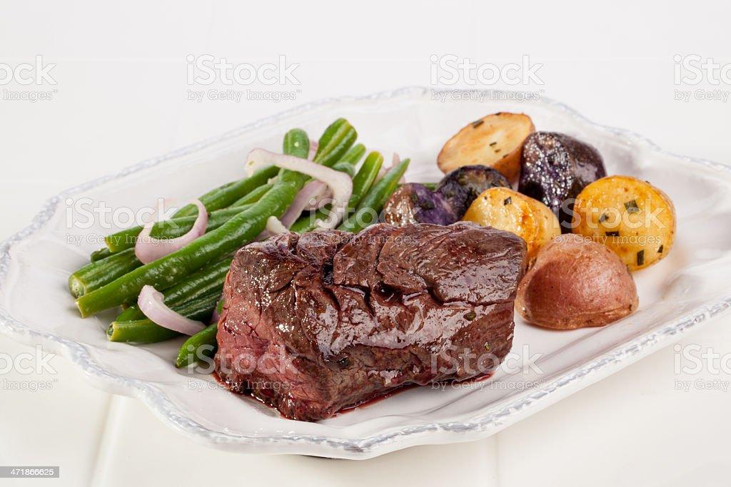 Hanger steak and Haricot Vert stock photo