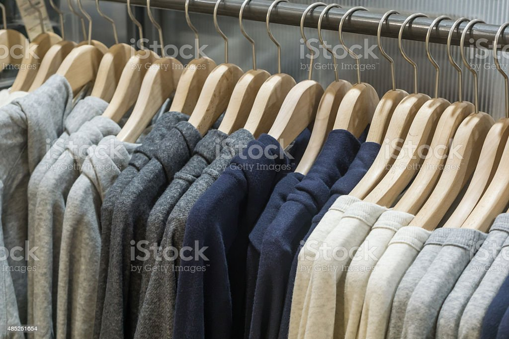 hangers in fashion clothes shop stock photo