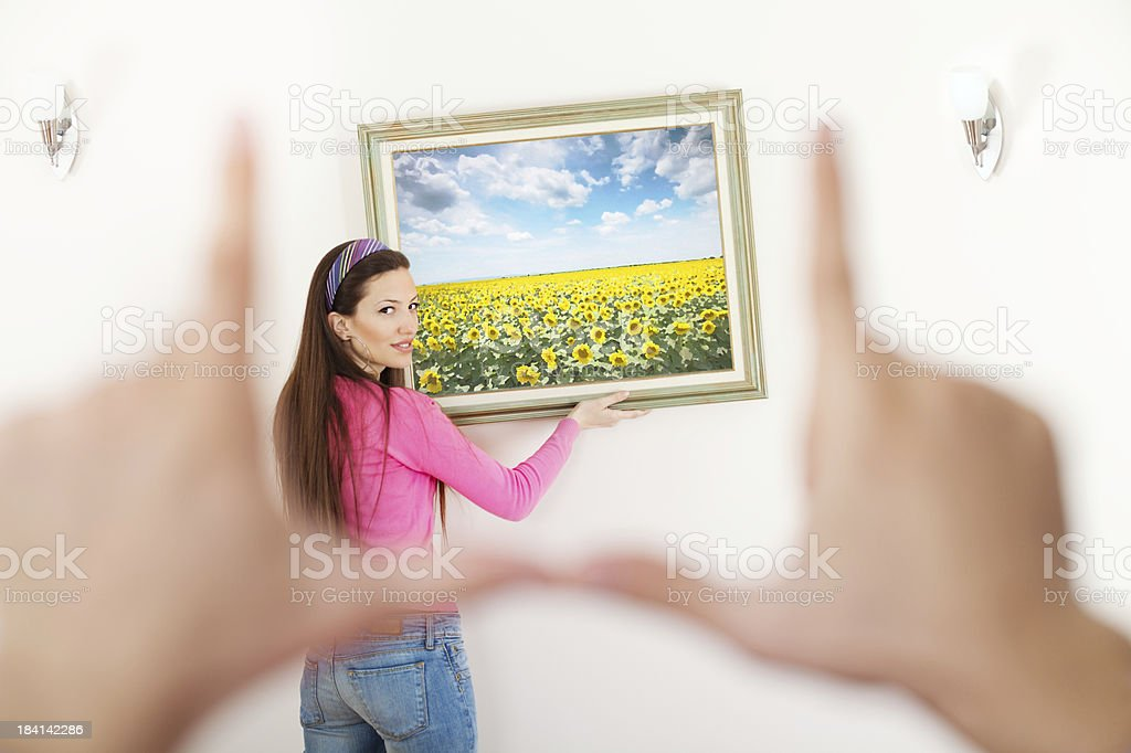 Hanging a painting in new home royalty-free stock photo