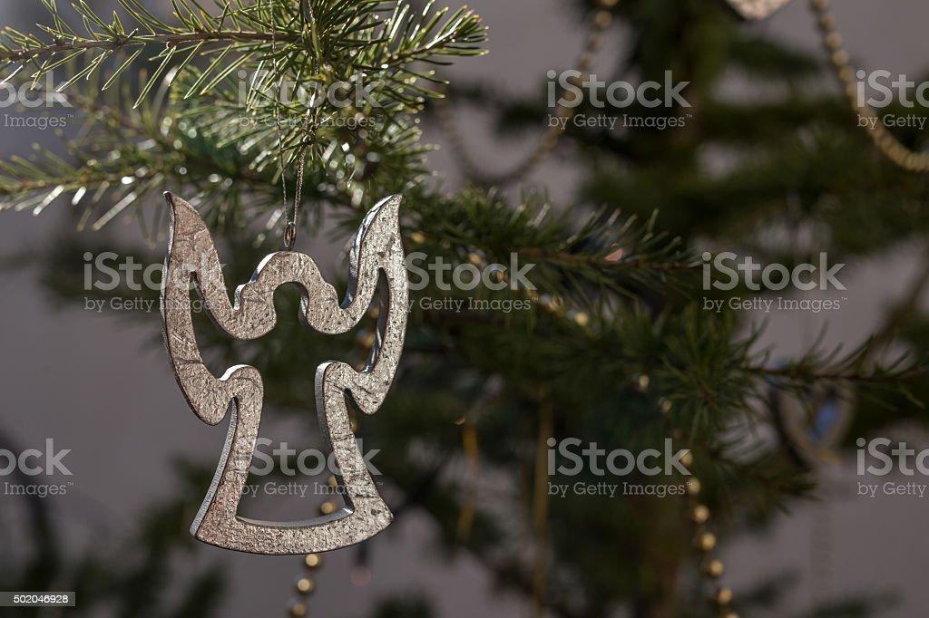 Hanging angel figurine, christmas tree decorative bauble stock photo